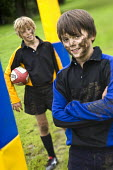 Playing Rugby. Clevedon community school, Clevedon. - Paul Box - ,2000s,2008,adolescence,adolescent,adolescents,ball,balls,boy,boys,child,CHILDHOOD,children,communities,community,Comprehensive School,edu,educate,educating,education,educational,field,game,games,juve