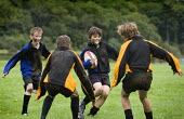 Playing Rugby. Clevedon community school, Clevedon. - Paul Box - 2000s,2008,adolescence,adolescent,adolescents,ball,balls,boy,boys,child,CHILDHOOD,children,communities,community,Comprehensive School,edu,educate,educating,education,educational,field,game,games,juven