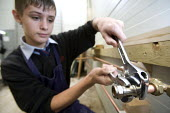 Tightening a junction on a pipe using an adjustable spanner, Bristol City Academy, Bristol. - Paul Box - ,2000s,2008,academies,Academy,adolescence,adolescent,adolescents,boy,boys,BUILDING,BUILDINGS,child,CHILDHOOD,children,cities,city,construction,Design Technology,edu,educate,educating,education,educati
