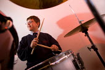 A drummer playing in the music studio, Bristol City Academy, Bristol. - Paul Box - 2000s,2008,academies,Academy,ACE,adolescence,adolescent,adolescents,arts,boy,boys,child,CHILDHOOD,children,cities,city,class,classroom,CLASSROOMS,culture,DRUM,drummer,drummers,drumming,DRUMS,edu,educa