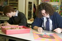 Art lesson, Bristol City Academy, Bristol. - Paul Box - 2000s,2007,academies,Academy,ACE,adolescence,adolescent,adolescents,art,arts,boy,boys,child,CHILDHOOD,children,cities,city,class,classroom,CLASSROOMS,crayon,crayons,culture,drawing,edu,educate,educati