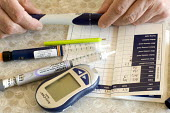 A diabetic testing his blood sugar levels at home with a testing kit - Paul Box - 10-08-2009
