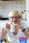 An elderly woman has a cup of tea. - Paul Box - 10-08-2009