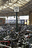 Bike park at Temple Meads railway station, Bristol. - Paul Box - ,2010s,2014,adult,adults,bicycle,bicycles,BICYCLING,Bicyclist,Bicyclists,BIKE,BIKES,Bristol,cities,city,COMMUTE,commuter,commuters,commuting,cycle,cycles,cycling,Cyclist,Cyclists,EBF,Economic,Economy,