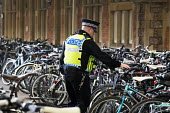 Police check bike locks at the bike park at Temple Meads railway station, Bristol. - Paul Box - 15-10-2014