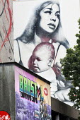 El Mac Mother and Child mural, Roll for the Soul community bike cafe a non profit cafe, city centre, Bristol. - Paul Box - 2010s,2014,ACE,art,arts,artwork,artworks,Bristol,building,buildings,cafe,cafes,catering,cities,city,communities,community,culture,graffiti,mural,MURALS,non profit,nonprofit,not for profit,outlet,outle