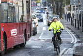 Commuter cyclists on Gloucester rd, Bristol. - Paul Box - ,2010s,2014,adult,adults,AUTO,AUTOMOBILE,AUTOMOBILES,AUTOMOTIVE,bicycle,bicycles,BICYCLING,Bicyclist,Bicyclists,BIKE,BIKES,Bristol,bus,bus service,buses,busy,car,cars,cities,city,COMMUTE,commuter,comm