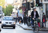 Commuter cyclists on Gloucester rd, Bristol. - Paul Box - 2010s,2014,adult,adults,AUTO,AUTOMOBILE,AUTOMOBILES,AUTOMOTIVE,bicycle,bicycles,BICYCLING,Bicyclist,Bicyclists,BIKE,BIKES,Bristol,busy,car,cars,cities,city,COMMUTE,commuter,commuters,commuting,cycle,c