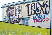 Think local boycott Tesco mural, Stokes Croft, Bristol. - Paul Box - �,2010s,2014,ACE,art,artwork,artworks,bought,boycott,boycott boycotting,Bristol,Bristol Pound,buy,buyer,buyers,buying,commodities,commodity,consumer,consumer consumers,consumers,critic,criticism,criti