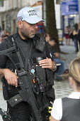 Armed Police Response Unit guard Cardiff city centre on the eve of the Nato summit. Cardiff, Wales - Paul Box - CTSFO,2010s,2014,adult,adults,and,armed,arms,automatic,baseball cap,Cardiff,CLJ,communicating,communication,conversation,conversations,counter terrorism,Counter Terrorist Specialist Firearms Officer,d