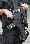 Armed Police Response Unit guard Cardiff city centre on the eve of the Nato summit. Cardiff, Wales - Paul Box - CTSFO,2010s,2014,adult,adults,and,armed,arms,automatic,baseball cap,Cardiff,CLJ,counter terrorism,Counter Terrorist Specialist Firearms Officer,fire,firearm,firearms,fires,force,g36,G36s,guard,gun,gun