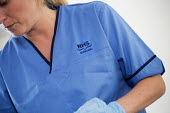 NHS scotland. Royal Victoria hospital, Edinburgh. - Paul Box - HEA,2010s,2014,blue,care,cleaner,cleaners,cleaning,cleansing,EARNINGS,EQUALITY,female,gown,HEA,Health,HEALTH SERVICES,healthcare,hospital,hospitals,Income,INCOMES,inequality,living wage,lothian,Low Pa
