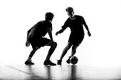 Silhouettes of pupils doing sport at Priory school, Weston Super Mare - Paul Box - 2010s,2014,ball,balls,child,CHILDHOOD,children,cities,city,dribble,edu,educate,educating,education,educational,football,footballer,game,games,juvenile,juveniles,kid,kids,knowledge,learn,learner,learne