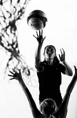 Silhouettes of pupils doing sport at Priory school, Weston Super Mare - Paul Box - 2010s,2014,activity,ball,balls,basket,basketball,child,CHILDHOOD,children,cities,city,edu,educate,educating,education,educational,female,females,game,games,girl,girls,hoop,juvenile,juveniles,kid,kids,