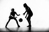 Silhouettes of pupils doing sport at Priory school, Weston Super Mare - Paul Box - 2010s,2014,activity,ball,balls,basket,basketball,child,CHILDHOOD,children,cities,city,edu,educate,educating,education,educational,female,females,game,games,girl,girls,juvenile,juveniles,kid,kids,knowl