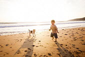 A toddler playing, Freshwater West beach, Pembrokeshire, Wales. - Paul Box - 21-09-2014