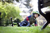 A toddler riding his balance bike. Bristol - Paul Box - ,2010s,2014,andrews,balance,bicycle,bicycles,BICYCLING,Bicyclist,Bicyclists,bike,bikes,boy,boys,child,CHILDHOOD,children,cities,city,cycle,cycles,cycling,Cyclist,Cyclists,EARLY YEARS,emotion,emotional