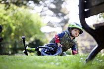 A toddler riding his balance bike. Bristol - Paul Box - 03-05-2014