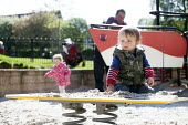 A toddler playing in the playground sandpit, St Andrews Park. Bristol - Paul Box - 03-05-2014