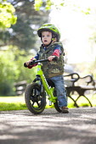 A toddler rides his balance bike. Bristol - Paul Box - 03-05-2014