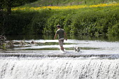 People enjoy the hot weather by Claverton Weir on the river Avon, near Bath. - Paul Box - 21-05-2014
