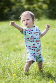 A toddler enjoying the hot weather near Bath. - Paul Box - 2010s,2014,boy,boys,child,CHILDHOOD,children,country,countryside,EARLY YEARS,enjoying,ENJOYMENT,field,grass,infancy,infant,infants,juvenile,juveniles,kid,kids,Leisure,LFL,LIFE,male,network,outdoors,ou