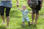 A toddler enjoys the hot weather by Claverton Weir on the river Avon, near Bath. - Paul Box - 21-05-2014