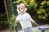 A toddler plays with a hula hoop, Stratford Upon Avon - Paul Box - 2010s,2014,boy,boys,child,CHILDHOOD,children,EARLY YEARS,garden,gardens,home,homes,in,juvenile,juveniles,kid,kids,Leisure,LFL,LIFE,male,out,people,play,playing,RECREATION,RECREATIONAL,sticking,toddler
