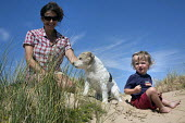 A mother with her son and pet dog, Freshwater West, Pembrokeshire. - Paul Box - 05-07-2014