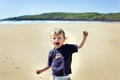 A toddler, Freshwater West, Pembrokeshire. - Paul Box - 2010s,2014,beach,beaches,boy,boys,child,CHILDHOOD,children,coast,coastal,coasts,country,countryside,dog,DOGS,EARLY YEARS,EMOTION,EMOTIONAL,EMOTIONS,happiness,happy,having fun,holiday,holiday maker,hol