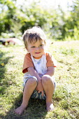 A toddler plays in a garden, Pembrokeshire, Wales - Paul Box - 06-07-2014