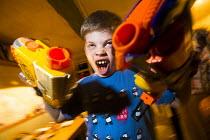 A boy playing with his Nerf guns, Ottery St Mary, Devon. - Paul Box - 2010s,2014,aggression,aggressive,Blaster,Blasters,boy,boys,child,CHILDHOOD,children,enjoying,enjoyment,fun,gun,guns,handgun,handguns,having fun,juvenile,juveniles,kid,kids,Leisure,LFL,LIFE,male,Nerf,p