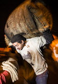 Flaming tar barrels are carried through the streets of Ottery St Mary, Devon. The barrels are covered in paraffin and lit. They are then carried on the backs of locals as they run through the streets.... - Paul Box - 05-11-2014