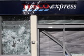 New Tesco store in Stokes Croft, Bristol was smashed up in anti Tesco riot - Paul Box - 25-04-2011