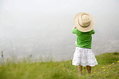 A young girl looking at the misty view at Freshwater West beach, Pembrokeshire. - Paul Box - 25-08-2007