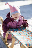 A young girl learning to sledge, Austria. - Paul Box - 2000s,2006,Austria,austrian,austrians,child,childhood,children,EMOTION,EMOTIONAL,EMOTIONS,eu,europe,european,europeans,eurozone,female,females,girl,girls,holiday,holiday maker,holiday makers,holidayma