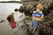 Children shrimping in Pembrokeshire. - Paul Box - 2000s,2008,boy,boys,child,CHILDHOOD,children,coast,coastal,coasts,EMOTION,EMOTIONAL,EMOTIONS,eni,environment,Environmental Issues,fisheries,fishery,fishing,Hand,holiday,holiday maker,holiday makers,ho