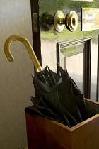 An umbrella by a front door, Bristol. - Paul Box - 2000s,2005,cities,city,CLIMATE,conditions,door,doors,home,homes,house,houses,precipitation,rain,rainfall,raining,umbrella,umbrellas,urban,wea,weather,wet