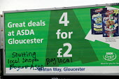 ASDA supermarket billboard graffiti with buy local message, against consolidation of food supply and the closure of local shops. - Paul Box - 2000s,2006,activist,activists,advert adverts,advertisement,advertisement advertisements,advertisement advertising,advertisements,Advertising,advertising advertisement,against,billboard,billboard billb