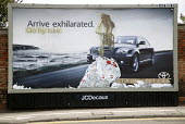 Toyota billboard car advertisement altered to feature a pro cycling slogan: Arrive exhilarated. Go by bike. Get a life get a bike - Paul Box - 2000s,2006,activist,activists,advert,ADVERTISED,advertisement,advertisements,advertising,ADVERTISMENT,adverts,advice,ADVISE,advising,against,AUTO,auto industry,AUTOMOBILE,AUTOMOBILES,Automotive,bicycl