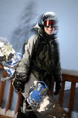 A snowboarder on the Alps, France. - Paul Box - 2000s,2005,EMOTION,EMOTIONAL,EMOTIONS,eu,Europe,european,europeans,eurozone,france,french,goggle,goggles,holiday,holiday maker,holiday makers,holidaymaker,holidaymakers,holidays,Leisure,LFL,LIFE,male,