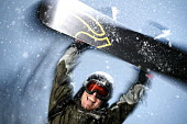 A snowboarder on the Alps, France. - Paul Box - ,2000s,2005,EMOTION,EMOTIONAL,EMOTIONS,enthusiasm,enthusiastic,eu,Europe,european,europeans,eurozone,france,french,goggle,goggles,happiness,happy,having fun,holiday,holiday maker,holiday makers,holida