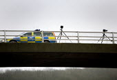 Police speed trap on a bridge over the M4 motorway. - Paul Box - ,2000s,2006,adult,adults,AUTO,AUTOMOBILE,AUTOMOBILES,AUTOMOTIVE,bridge,bridges,CAR,cars,CLJ,crime,highway,MATURE,motorway,MOTORWAYS,observation,observing,Police,Police Car,Police Surveillance,policing