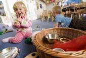 Children playing with a treasure basket at Dulverton Children's Centre, Somerset. - Paul Box - 09-10-2008