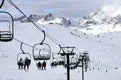 A ski lift on the Alps, France. - Paul Box - 2000s,2007,adult,adults,aerial,chairlift,couple,COUPLES,eu,Europe,european,europeans,eurozone,FEMALE,france,french,hill,hills,holiday,holiday maker,holiday makers,holidaymaker,holidaymakers,holidays,j
