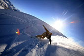 A snowboarder on the Alps, France. - Paul Box - 2000s,2007,Château-d'Œx,eu,Europe,european,europeans,eurozone,france,french,hill,hills,holiday,holiday maker,holiday makers,holidaymaker,holidaymakers,holidays,Leisure,LFL,LIFE,male,man,men,PEOPLE,p