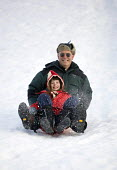 A father takes his daughter sledging the Alps, France. - Paul Box - 2000s,2006,child,CHILDHOOD,children,DAD,DADDIES,DADDY,DADS,daughter,DAUGHTERS,EMOTION,EMOTIONAL,EMOTIONS,enthusiasm,enthusiastic,eu,Europe,european,europeans,eurozone,families,family,father,FATHERHOOD