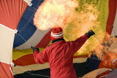Inflating a hot air balloon at the Chateaux dOex Balloon Festival, Switzerland. - Paul Box - 25-01-2006