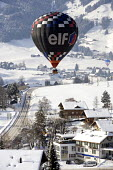 An Elf hot air balloon at the Chateaux dOex Balloon Festival, Switzerland. - Paul Box - 27-01-2006