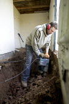 A worker uses a jackhammer on a refurbishment. - Paul Box - 16-02-2008